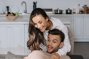 happy young couple using tablet toge
