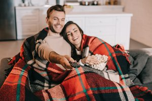 happy young couple watching tv with