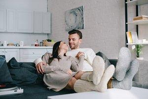 happy couple in woolen socks relaxin