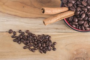 Coffee beans with cinnamon in a cup