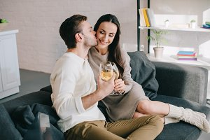 beautiful young couple drinking wine
