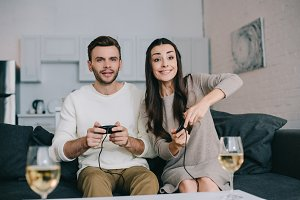happy young couple playing retro vid