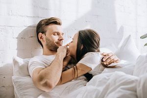 happy young couple relaxing in bed t