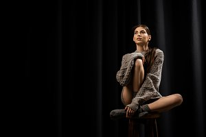 beautiful pensive woman in woolen gr