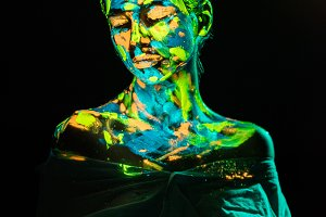 model with colorful neon paints on b