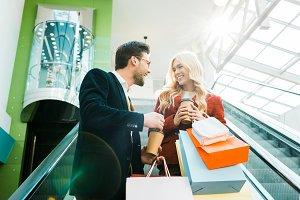 happy stylish couple with shopping b