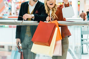 young couple with shopping bags spen