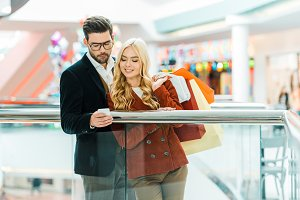 young stylish couple with shopping b