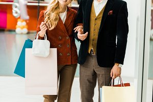young happy couple with shopping bag