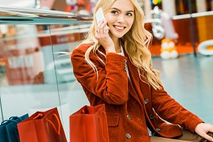 attractive smiling shopaholic talkin