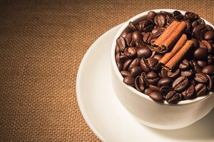 Coffee beans in a cup on jute