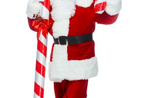 happy santa claus standing with big