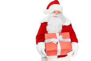 santa claus holding red christmas gi