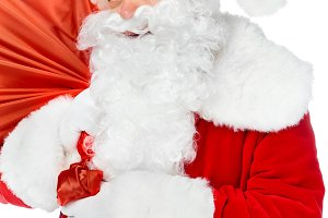 smiling santa claus carrying red chr