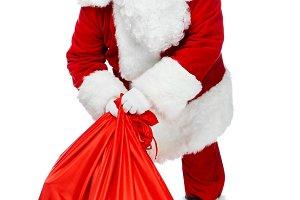 santa claus holding red christmas ba