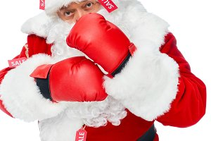 santa claus in boxing gloves and red