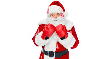 serious santa claus in boxing gloves