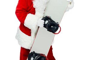 Santa claus standing with snowboard