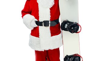 Santa claus posing with snowboard is