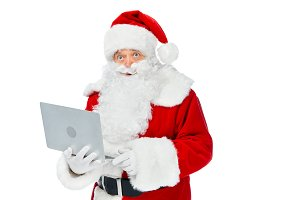 bearded santa claus using laptop iso