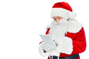 santa claus using digital tablet iso