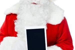 santa claus presenting digital table
