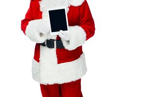 happy santa claus showing digital ta