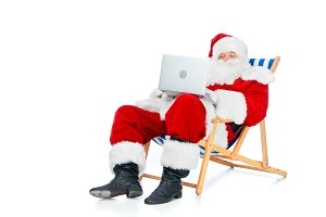 santa claus using laptop while resti