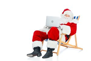 santa claus using laptop while sitti