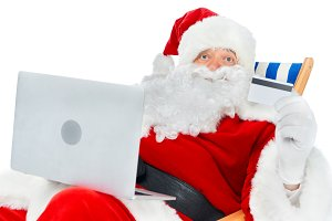 santa claus shopping online with lap