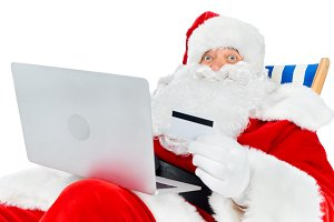 smiling santa claus shopping online