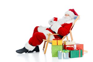 santa claus holding coffee cup and s