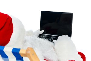 santa claus using laptop with blank