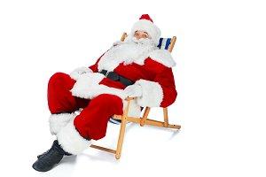 happy santa claus resting on beach c