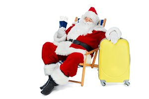 santa claus holding two passports an