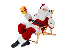 santa claus holding present and cham
