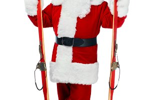 santa claus holding skis isolated on