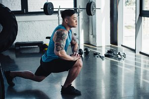 focused young sportsman doing lunge
