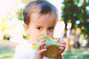 Cute Baby Boy Drinking Milk Bottle
