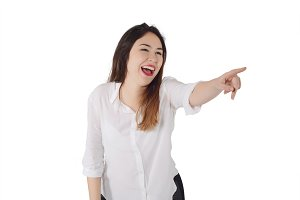 Young woman laughing and pointing so