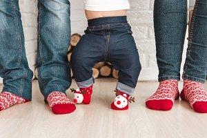 Feet in socks.Christmas ornament