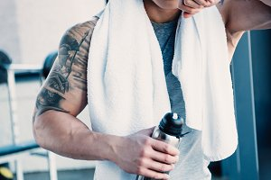 young tired sportsman with towel and