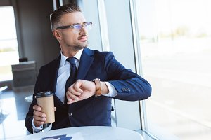 handsome businessman in glasses with