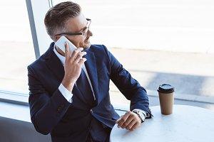 adult businessman in glasses talking