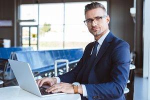 handsome businessman in glasses look