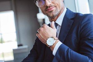 handsome businessman in glasses usin