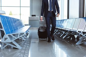 businessman with travel bag walking