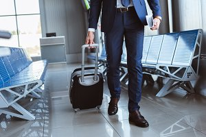close up of businessman with luggage