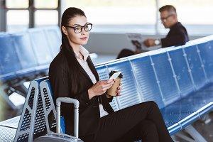 young businesswoman in glasses sitti