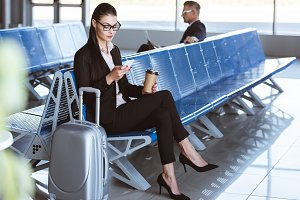 young businesswoman in glasses using
